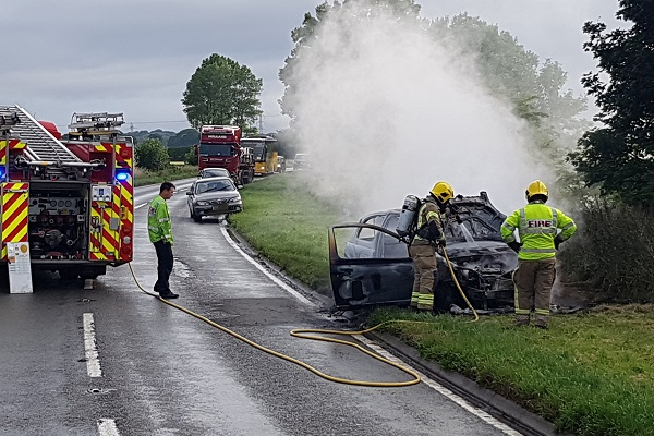 Car catches fire on main road
