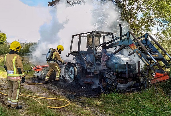 Tractor wrecked by fire at farm
