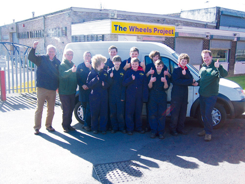 Will Mansell Manager of Stroud Foodbank and regional Manager Phil Coysh take delivery from the Wheels Project Team from Chipping Sodbury School